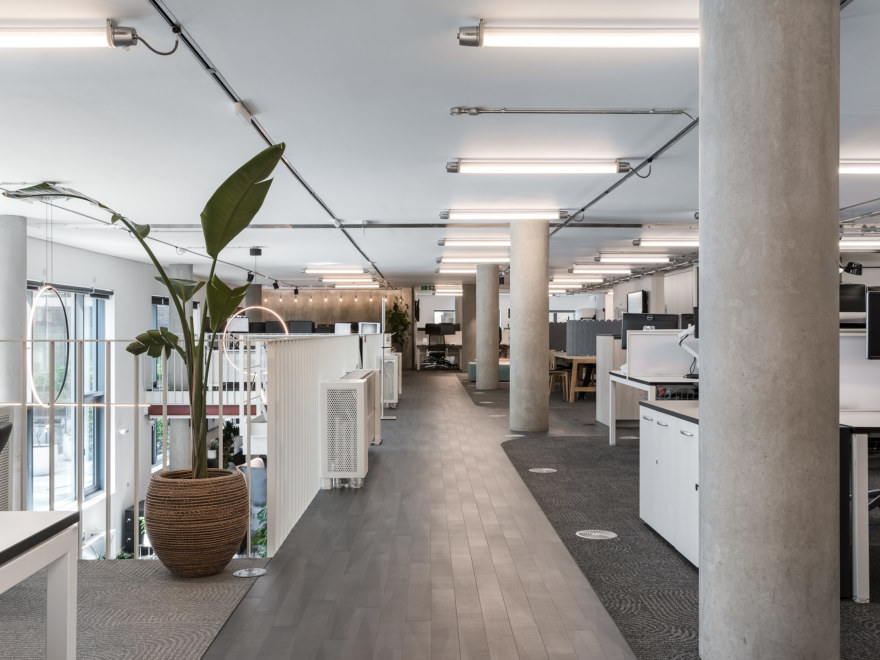 Open plan office space with individual bookable desks.