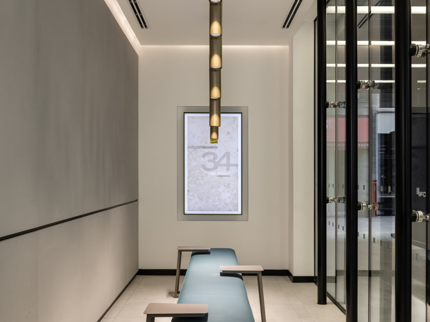 Concrete and warm-toned porcelain are balanced throughout with subtle lighting.